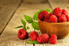 Fresh raspberries on a wooden table. Forest fruit. Healthy food. Sale of raspberries. Fresh raspberries on a wooden table. Forest fruit. Healthy food. Sale of Royalty Free Stock Photo