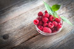 Fresh raspberries on a wooden table stock image