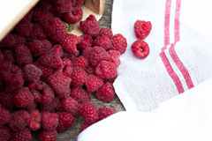 Fresh raspberries on a wooden table. Raspberry in a basket Stock Photography