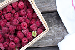 Fresh raspberries. On a wooden table. Raspberry in a basket Royalty Free Stock Photo