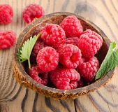 Fresh raspberries. On a wooden table .Selective focus Stock Photos