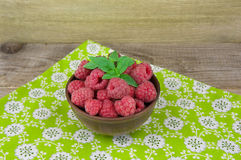 Fresh raspberries on a wooden table .Selective focus.  Royalty Free Stock Image