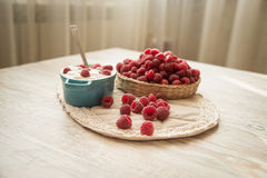 Fresh raspberries with yogurt. On the table Royalty Free Stock Images