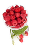Fresh raspberry. In a vase over white background Stock Images