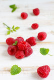 Fresh raspberry. With lemon balm leaves Stock Photo