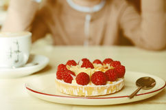 Fresh raspberry and almond tart on a table in cafe. Fresh raspberry and almond tart on a plate in cafe Stock Photos