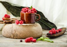Fresh raspberry with basil in a cup of coffee and a wooden stand. Detox diet food and raw vegan concept.Horizontal Royalty Free Stock Photo