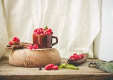 Fresh raspberry with basil in a cup of coffee and a wooden stand. Detox diet food and raw vegan concept. Tone..Place for text Stock Image