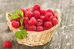 Fresh raspberry. In the basket Stock Photos