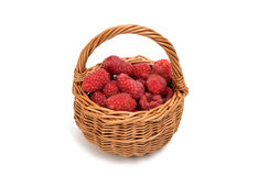 Fresh raspberry in a basket isolated. On a white background Stock Photo