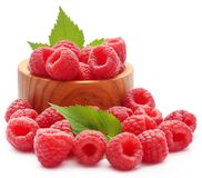 Fresh Raspberry. In a basket over white background Stock Photos