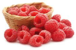 Fresh Raspberry in a basket. Over white background Royalty Free Stock Photo