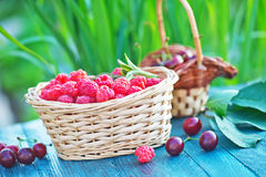 Fresh raspberry. In basket and on a table Stock Photos