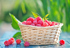 Fresh raspberry. In basket and on a table Stock Photo