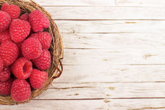 Fresh raspberry in a basket on  table. Fresh raspberry in a basket on wooden table Stock Image