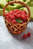 Fresh raspberry. In a basket on wooden background Stock Photography