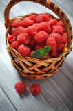 Fresh raspberry. In a basket on wooden table closeup Royalty Free Stock Images