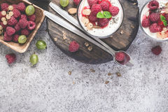Fresh raspberry berries with yogurt or cream in glasses. Summer. Breakfast Dessert Concept Stock Photo