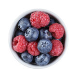 Fresh raspberry and blueberry in bowl directly. Above, isolated on white background Stock Images
