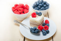 Fresh raspberry and blueberry cake. Fresh homemade raspberry and blueberry cream cake Stock Photography