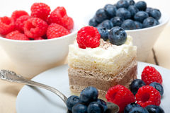 Fresh raspberry and blueberry cake. Fresh homemade raspberry and blueberry cream cake Royalty Free Stock Photography