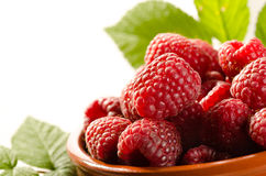 Fresh raspberry in the bowl with leaves Royalty Free Stock Photos
