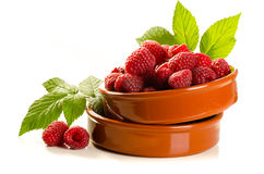 Fresh raspberry. In the bowl macro isolated on white Stock Image