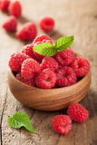 Fresh raspberry in bowl over wooden background Royalty Free Stock Photos