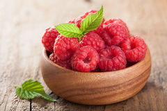 Fresh raspberry in bowl over wooden background Royalty Free Stock Photography