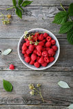 Fresh raspberry in bowl top view. Summer berry Stock Photo