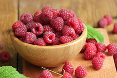 Fresh raspberry  in bowl. Fresh raspberry on the wooden table Stock Photography