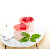 Fresh raspberry cake mousse dessert. Round shape with mint leaves Stock Image