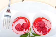 Fresh raspberry cake mousse dessert. Round shape with mint leaves Stock Photography