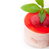 Fresh raspberry cake mousse dessert. Round shape with mint leaves Stock Images