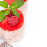 Fresh raspberry cake mousse dessert. Round shape with mint leaves Royalty Free Stock Images