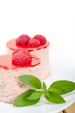 Fresh raspberry cake mousse dessert. Round shape with mint leaves Stock Photos