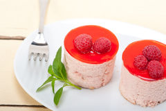 Fresh raspberry cake mousse dessert. Round shape with mint leaves Royalty Free Stock Photography