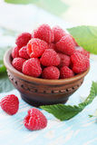 Fresh raspberry, in ceramic bowl. Fresh big juicy raspberry in a bowl Stock Photo