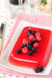 Fresh Raspberry and Champagne Jelly. Raspberry and Champagne Jelly Garnished with Fresh Berries, selective focus on berries, copy space for your text Royalty Free Stock Images