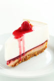 Fresh raspberry cheesecake. On white plate Royalty Free Stock Photo