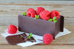 Fresh raspberry in chocolate box. Raspberry with mint leaves in chocolate box Royalty Free Stock Photos