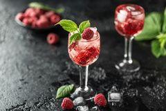 Fresh raspberry cocktail. Fresh summer cocktail with raspberry and ice cubes. Glass of raspberry mojito Stock Photo