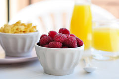 Fresh raspberry. And corn flakes in ceramic bowl closeup Royalty Free Stock Images