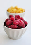 Fresh raspberry. Corn flakes and fresh raspberry  in ceramic bowl closeup Royalty Free Stock Image