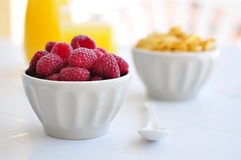Fresh raspberry. Corn flakes and fresh raspberry  in ceramic bowl closeup Royalty Free Stock Photos