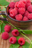 Fresh raspberry in cup on wooden table Royalty Free Stock Photography