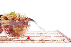 Fresh Raspberry and currant in a crystal bowl. On white Royalty Free Stock Image