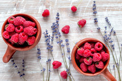 Fresh raspberry and dry lavander in rustic design wooden background top view. Fresh raspberry in pots and lavander dry flowers in rustic design on wooden Royalty Free Stock Image