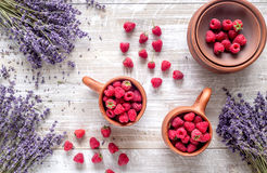 Fresh raspberry and dry lavander in rustic design wooden background top view. Fresh raspberry in pots and lavander dry flowers in rustic design on wooden Royalty Free Stock Photos
