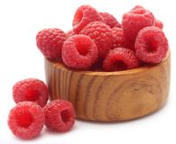 Fresh Raspberry. In a wooden bowl over white background Stock Photo